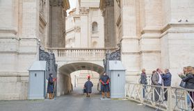 Vatican City, Rome, Italy - February 16, 2015: The gate with swiss guards for entrance to the residence of the Vatican. Rome stock photo