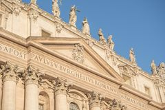 Vatican City, Rome, Italy - February 16, 2015: Part of the facade of the building in the Vatican, Rome, Italy. Architectural features of ancient times royalty free stock image