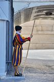 Swiss Guard guards the Gate of St. Peter`s Basilica in Vatican State City. Vatican City, Rome, Italy, September 12, 2015: Swiss Guard guards the Gate of St royalty free stock photography
