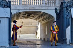 Swiss Guards guard the Gate of St. Peter`s Basilica in Vatican State City. Vatican City, Rome, Italy, September 12, 2015: Swiss Guards guard the Gate of St stock photography