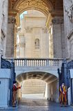 Swiss Guards guard the Gate of St. Peter`s Basilica in Vatican State City. Vatican City, Rome, Italy, September 12, 2015: Swiss Guards guard the Gate of St stock images