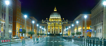 Vatican City in Rome by night with a view over St Peters Basilica Stock Images
