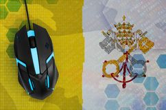 Vatican City State flag and computer mouse. Digital threat, illegal actions on the Internet. Vatican City State flag and modern backlit computer mouse. The stock images
