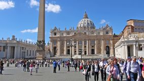 VATICAN CITY, VATICAN - March 26, 2017: Tourists visiting the Square and the Basilica of St. Peter in Rome. Zoom stock video footage