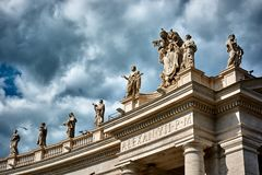 Statues on top of the Tuscan colonnades. VATICAN CITY, VATICAN - MAY 17, 2017: Some of the statues on top of the Tuscan colonnades in Saint Peter's square in Stock Photos