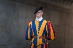 VATICAN CITY, VATICAN - SEPTEMBER 3: Famous Swiss Guard surveil basilica entrance on September 3, 2014 in Vatican. The Papal Guard Royalty Free Stock Photography