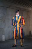 VATICAN CITY, VATICAN - SEPTEMBER 3: Famous Swiss Guard surveil basilica entrance on September 3, 2014 in Vatican. The Papal Guard Royalty Free Stock Photo