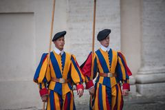 VATICAN CITY, VATICAN - SEPTEMBER 3: Famous Swiss Guard surveil basilica entrance on September 3, 2014 in Vatican. The Papal Guard Stock Image