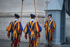 VATICAN CITY, VATICAN - SEPTEMBER 3: Famous Swiss Guard surveil basilica entrance on September 3, 2014 in Vatican. The Papal Guard Stock Photo