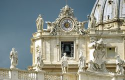 The Vatican Clock. Sculptures and watches at the cathedral of Peter and Paul in the Vatican Royalty Free Stock Photo
