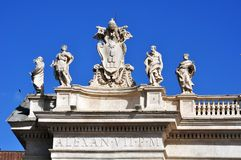 Some sculptures depicting the 140 saints of the colonnade of the Vatican City. On the Vatican colonnade there are 140 statues of saints and the great coats of royalty free stock photo