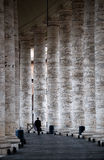 Vatican columns. A view of a man's back in columns, St Peter church,Vatican Royalty Free Stock Photo