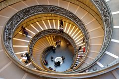 Spiral staircase in the Vatican Museums. VATICAN,  VATICAN - DECEMBER 29, 2017: Spiral staircase, created in 1932 by Giuseppe Momo in the Vatican Museums Royalty Free Stock Photography