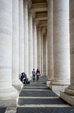 Vatican. Enamoured pair between the colonnades. Stock Image