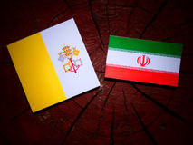 Vatican flag with Iranian flag on a tree stump isolated Royalty Free Stock Photo