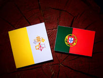 Vatican flag with Portuguese flag on a tree stump isolated. Vatican flag with Portuguese flag on a tree stump royalty free illustration