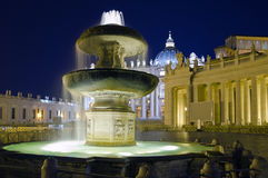 Vatican Fountain by night. View of Carlo Maderno's Fountain in St. Peter's Square, Vatican City, Rome. The Maderno fountain is located  on the north side of the Royalty Free Stock Images
