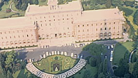 Vatican Governor`s Palace. Aerial view of Vatican Governor`s Palace and Vatican gardens from top of Saint Peter basilica church in Rome city of Italy. Historic stock footage