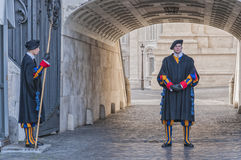 Vatican Guards. VATICAN - JANUARY 08: Unidentified papal Swiss guards stands at a non-public door of the Vatican on January 08, 2014 in the Vatican. The Swiss royalty free stock images