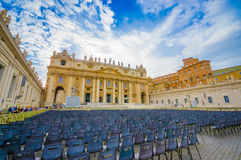 VATICAN, ITALY - JUNE 13, 2015: Everything ready for weekly general papal audience outside Basilica at Vatican. Saint Peter Basilica with chairs outside Stock Photography