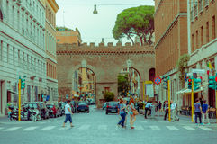 VATICAN, ITALY - JUNE 13, 2015: Historical street in Rome before entering to Vatican city, people crossing the street Royalty Free Stock Photos