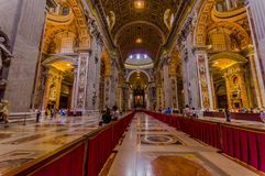 VATICAN, ITALY - JUNE 13, 2015: Saint Peter church in Vatican, main hall inside, turists walking around. Royalty Free Stock Photography