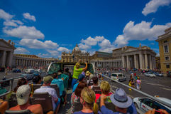 VATICAN, ITALY - JUNE 13, 2015: Turists bus visiting the most important places in Rome city, people watching from their Stock Photo