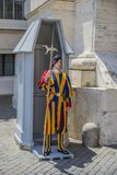 Vatican - June 19, 2014 : Pontifical Swiss Guard soldier guards entrance. A guard stands in front of a guard station royalty free stock images