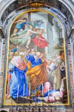 Paintings and mosaics in the Saint Peter basilica in Vatican. VATICAN - MARCH 13, 2016: In the Renaissance artists created paintings made with tessera mosaic Royalty Free Stock Images