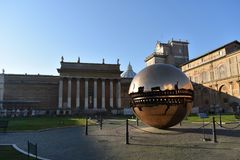 Vatican museum yard. The vatican museum yard with the central copper sphere royalty free stock image