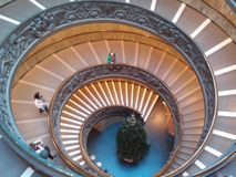 Vatican Museums, arch, symmetry, daylighting, ceiling. Vatican Museums is arch, ceiling and building. That marvel has symmetry, stairs and window and that beauty Stock Photos