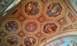 Vatican Museums, dome, ceiling, carving, symmetry. Vatican Museums is dome, symmetry and place of worship. That marvel has ceiling, building and byzantine Royalty Free Stock Photo