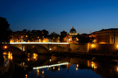 Vatican at Night. The Vatican in Rome, Italy at night. With The river Tiber, Tevere, in the foreground Stock Photo