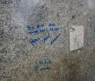 The wall with nonsense texts stock images