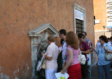 Vatican. The queue for drinking water on the streets of Rome royalty free stock images