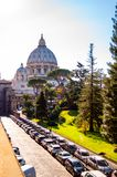 The dome of the Papal Basilica of St. Peter in the Vatican or simply St. Peter`s Basilica from backyard garden full of trees and. Vatican, Rome, Italy - November royalty free stock photo
