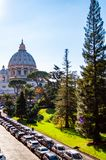 The dome of the Papal Basilica of St. Peter in the Vatican or simply St. Peter`s Basilica from backyard garden full of trees and. Vatican, Rome, Italy - November royalty free stock photos