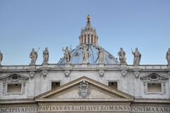 Vatican St. Peter's Basilica in Rome, Italy. A shot of St. peter's basilica statues and dome Stock Photos