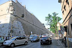 Vatican , Rome, Italy. Tourist wait outside the Vatican City Wall for  to enter the Vatican Stock Photo
