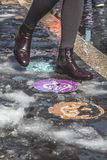 Italian Leather Waypoints. Vatican waypoints on the ground mark the direction for pilgrims featuring Italian leather boots in the snow Royalty Free Stock Photos