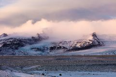 Vatnajökull National Park glacier among the mountains. Sunrise in the beautiful Vatnajökull National Park on the Southern shores of Iceland on a cold royalty free stock photos