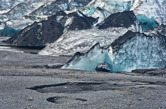 Vatnajokull glacier detail covered with volcanic ash is melting Stock Photography