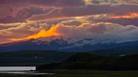 Vatnajokull glacier at sunset from black beach near Vik,Iceland Stock Photo