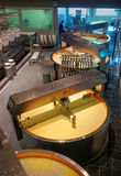 Vats and rounds in the cheese making room Stock Photo
