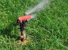 vatten för 5 sprinkler Arkivbild