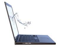 vatten för bärbar datorskärmfärgstänk Arkivfoto