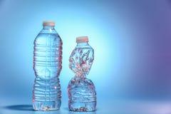 vatten för flaskor två Arkivfoton