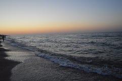Vatten för solnedgång på havet arkivbild