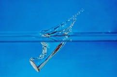 vatten för 2 färgstänk Fotografering för Bildbyråer