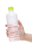 vatten för flaskhandholding Royaltyfria Bilder